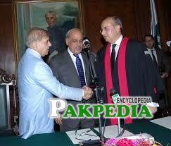 Shaking hand with CM punjab