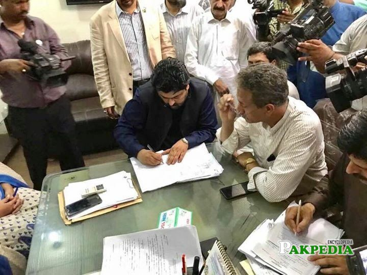 While signing the nomination papers for elections