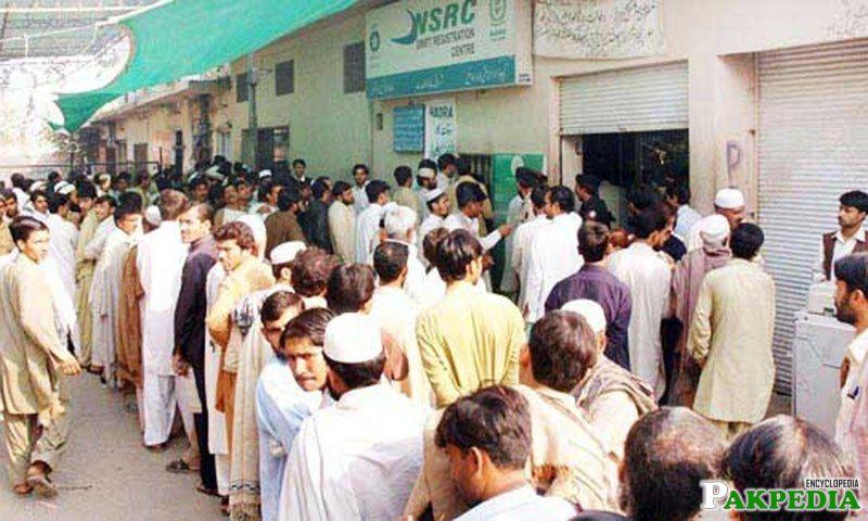 People waiting for the turn to receive ID cards from a NADRA office