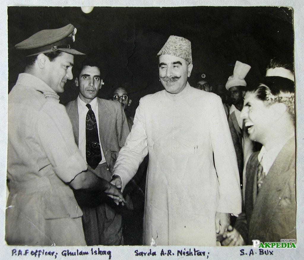 With Ghulam Ishaq