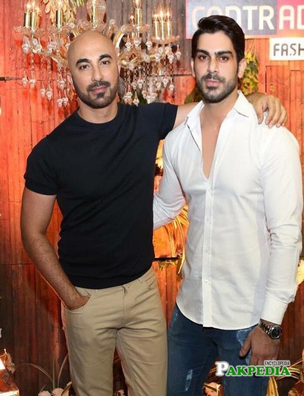 Waleed Khalid with HSY at an event