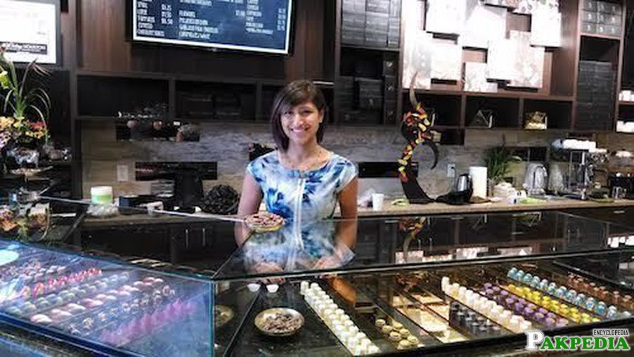 Standing in her cacao shop