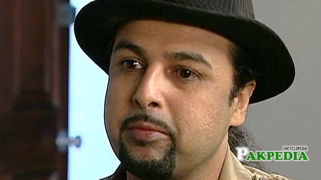 Salman Ahmad in a Black Hat