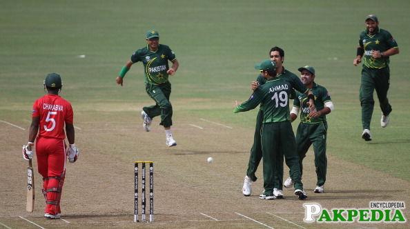 Umar Gul celebrating with team