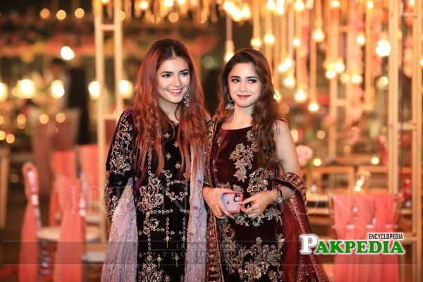 Momina with Aima Baig at an event