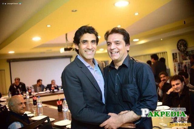 Aun Chaudhry with Usman Dar in a meeting
