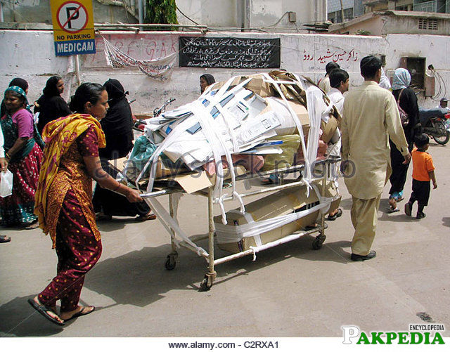 Garbage being dumped on a stretcher at civil hospital in Karachi
