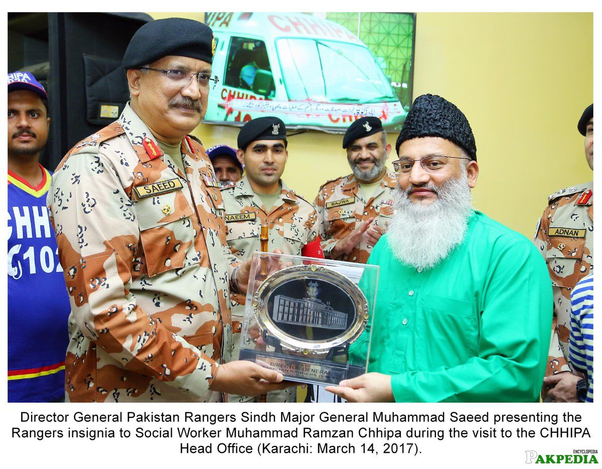 Director General Pakistan Rangers Sindh Major General Muhammad Presenting the Rangers Insignia to Social Worker Muhammad Ramazan
