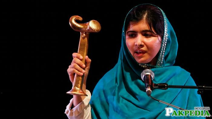 Malala Yousafzai displaying her medal during the award ceremony