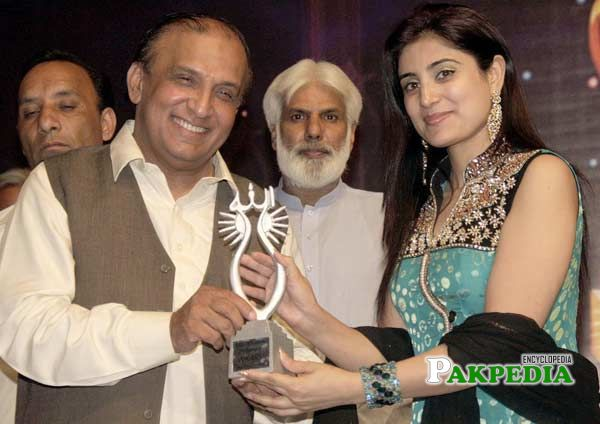 While giving award to an actress in an award ceremony