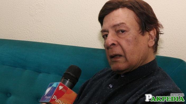Qavi Khan talking to media