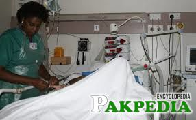 Aga Khan University Hospital nursing officer attends to a patient at the ICU in the casualty department.