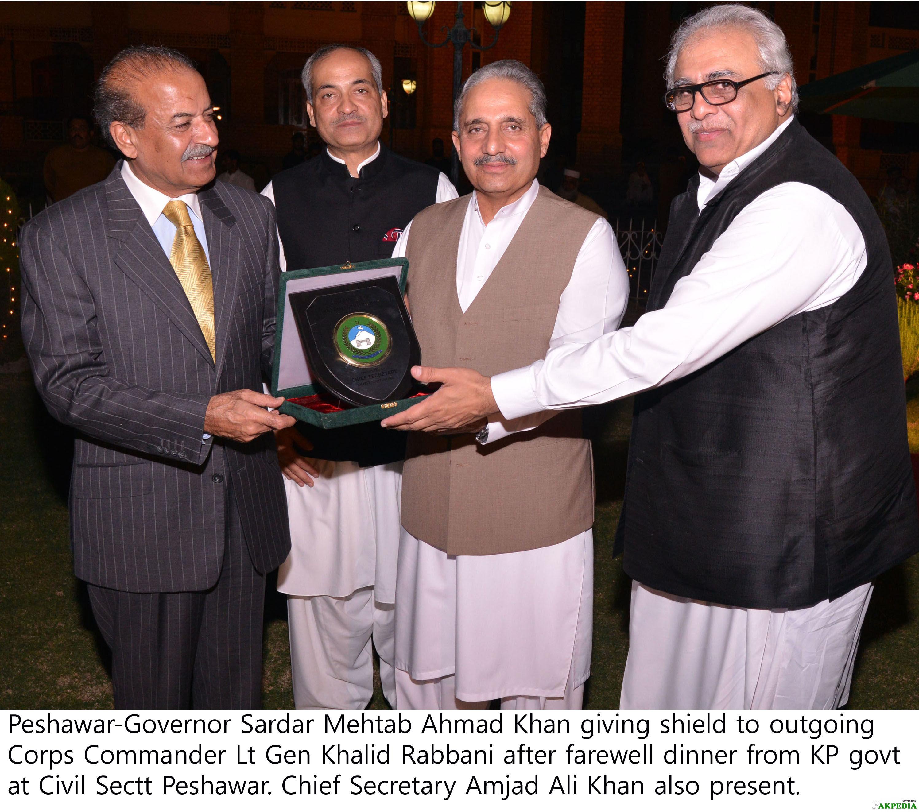 Peshawar Governor Sardar Mehtab Ahmad Khan giving shield to outgoing Commander