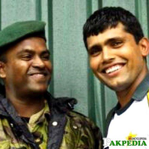 Kamran Akmal with a soldier