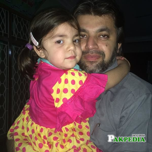Ali Muhammad with his daughter