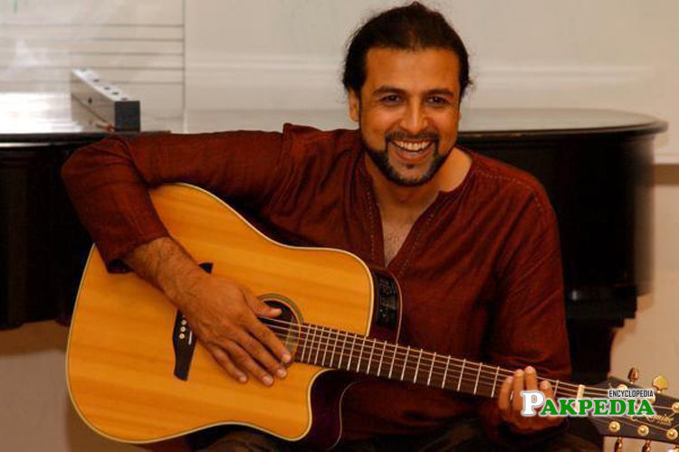 Salman Ahmad playing a guitar