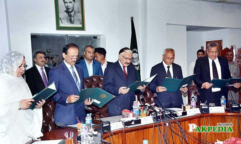 Justice raza taking oath from other members of EC