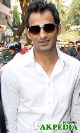 Shoaib Malik in white shirt