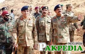 Ahmad Shuja Pasha with Soldiers