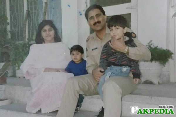 Qamar Javed Bajwa with his wife and two sons