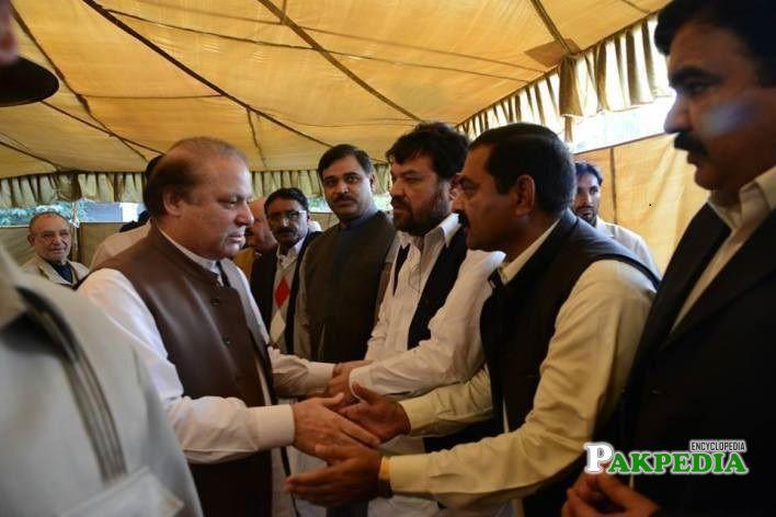 Muhammad Ashraf Rasool with the members of PMLN