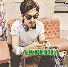 In this picture Uzair Jaswal playing with his mobile