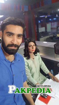 With a newscaster