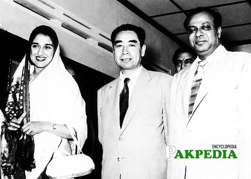 With his first wife and chineese leader