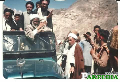 Shaheed allama waving hands to poeple