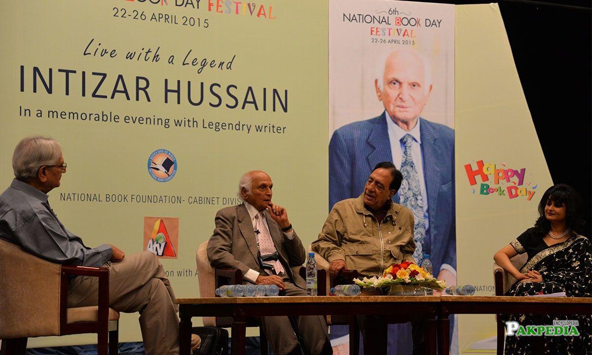 Intizar Husain seen with Ata ul Haq Qasmi at a panel discussion held at the National Book