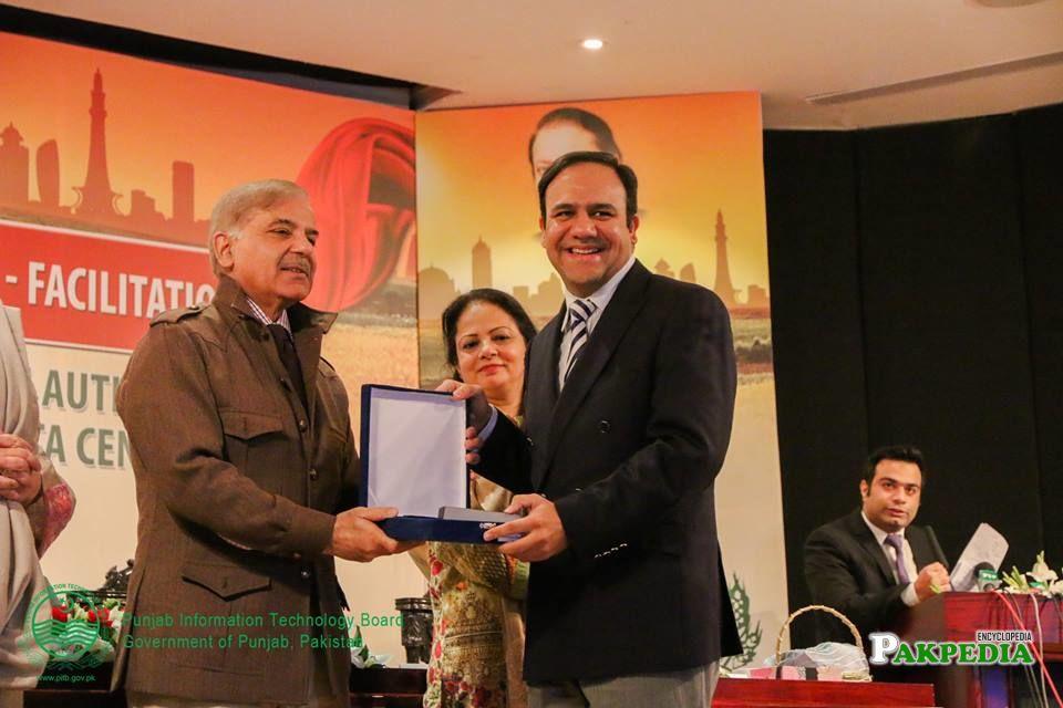 Receiving award from CM of punjab