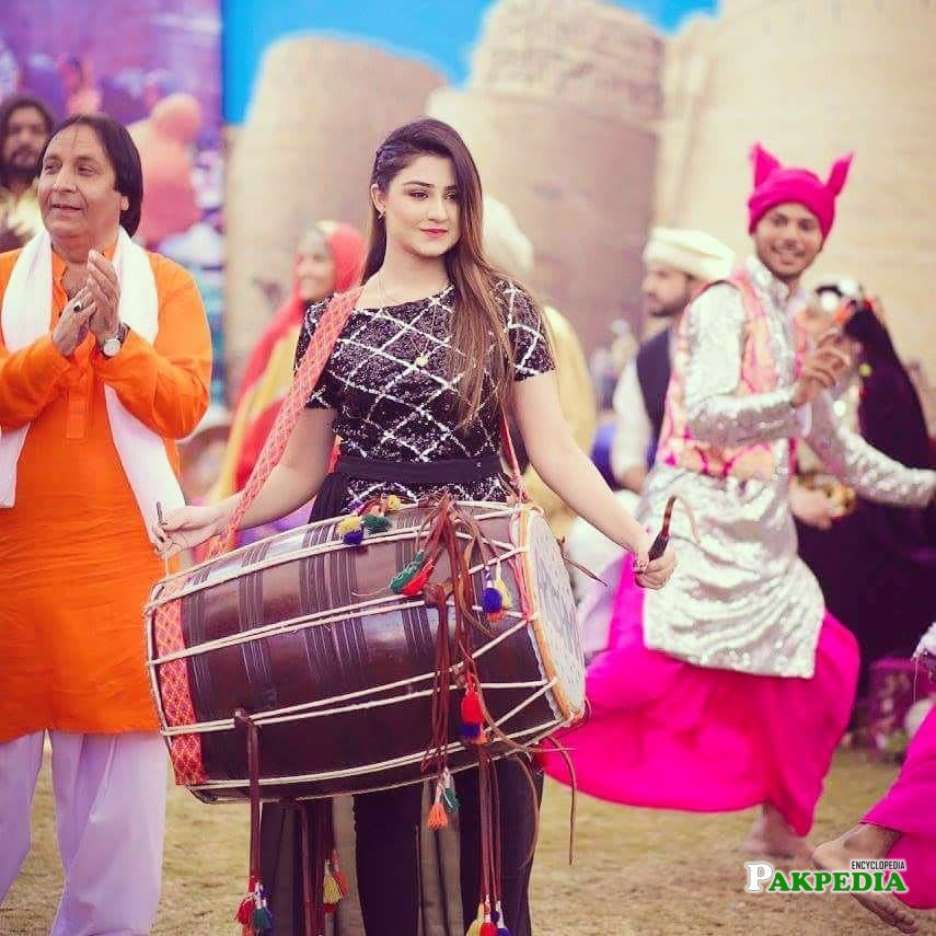 Playing Dhol in an Event