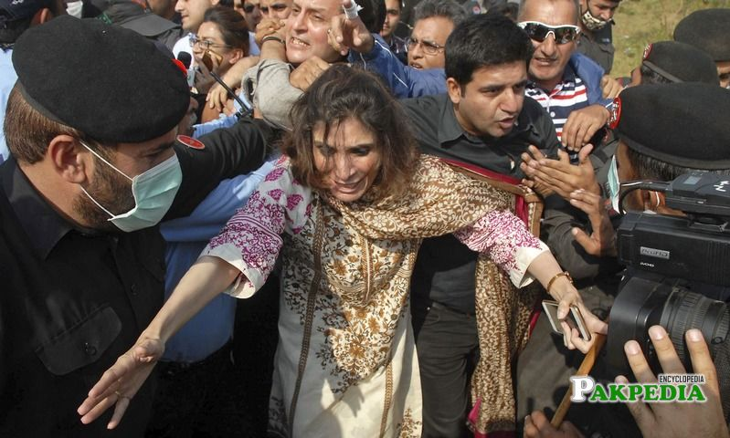 Police arresting Andleeb abbas during protest