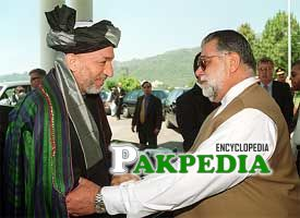 While shaking hands with Afghan president