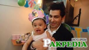 Faakhir Mehmood with child