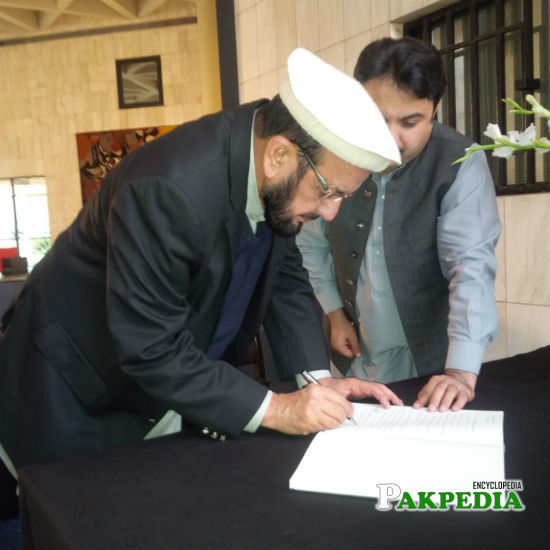 Mr. Bismillah Khan, Member National Assembly from Bajaur Tribal Area (FATA) signing the condolence book at the French Embassy