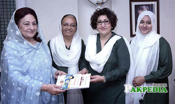 Presenting Publications to Senator Razina Alam Malik