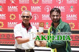 Awais while receiving trophy