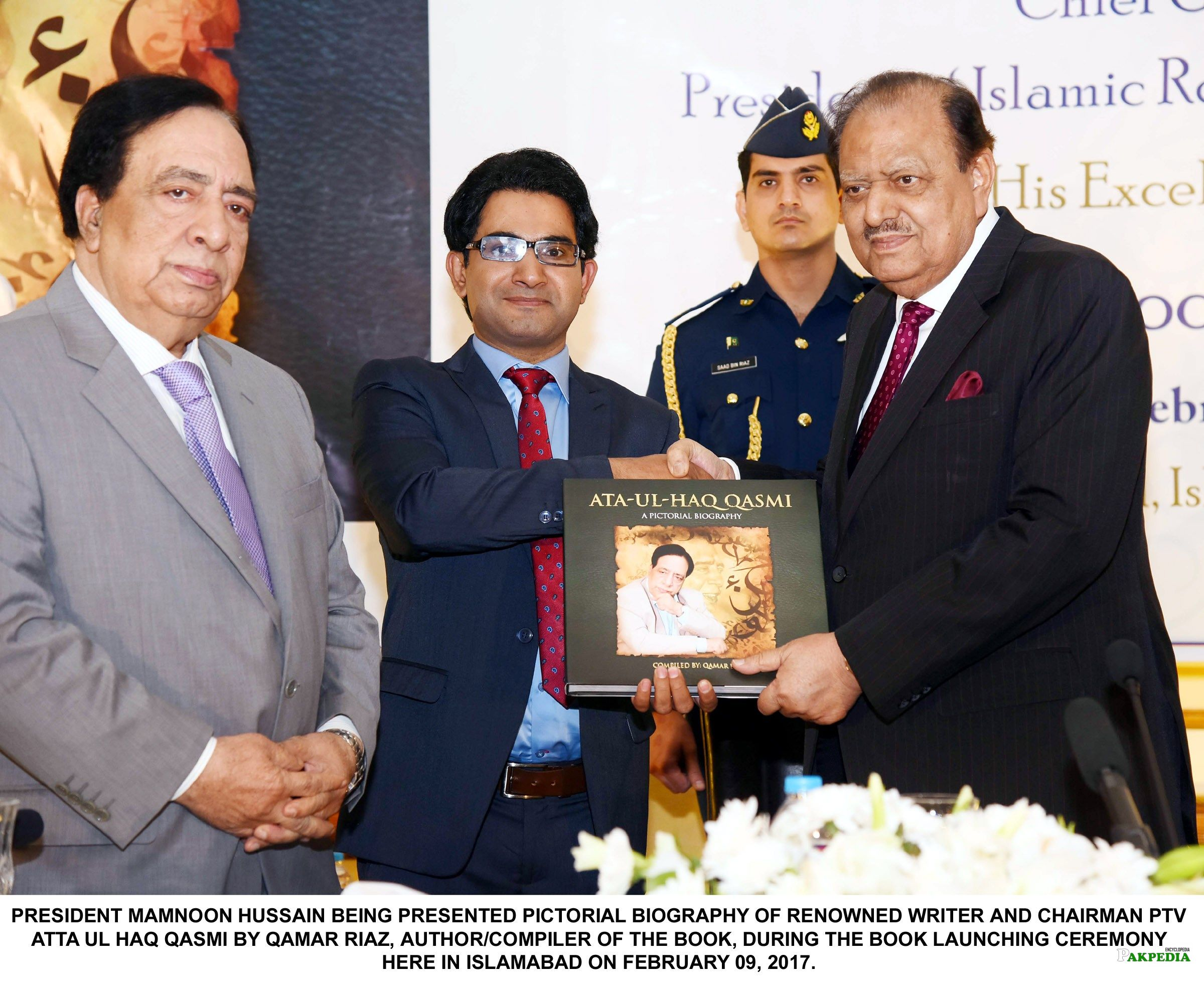 President Mamnoon Hussain Being Presented Pictorial Biography Of Renowned Writer And Chairman PTV Atta Ul Haq Qasmi