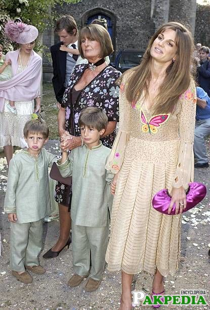 Jemima with her sons at a wedding