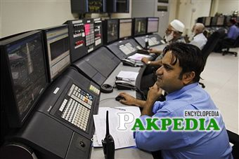 Attock Refinery Ltd. (ARL) employees work in the control room of the company's