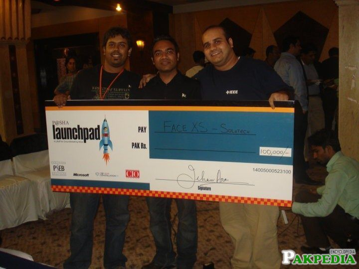 Farhan Masood Give a Cheque