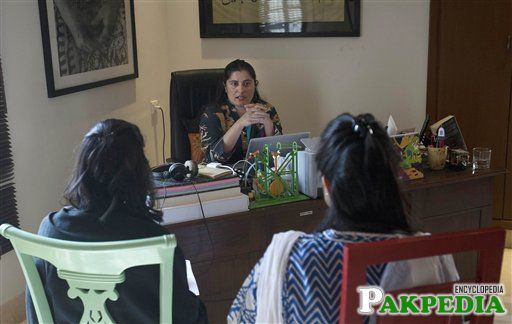 Sharmeen Obaid-Chinoy discusses with colleagues at her office in Karachi, Pakistan. Obaid-Chinoy is nominated for a second Oscar for her moving story