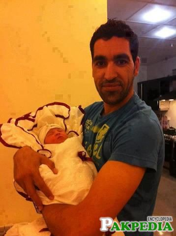 Umar Gul with his Child