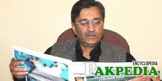 Muhammad Pervaiz Malik read a News Paper