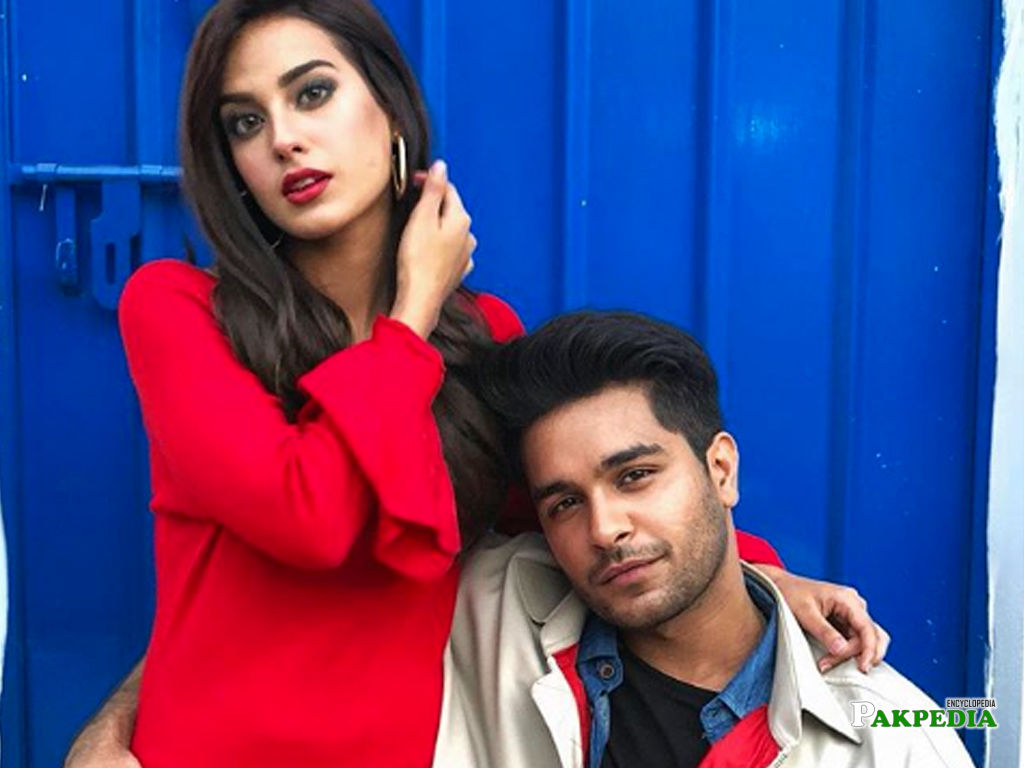 Asim Azhar with Iqra Aziz during a shoot for a song
