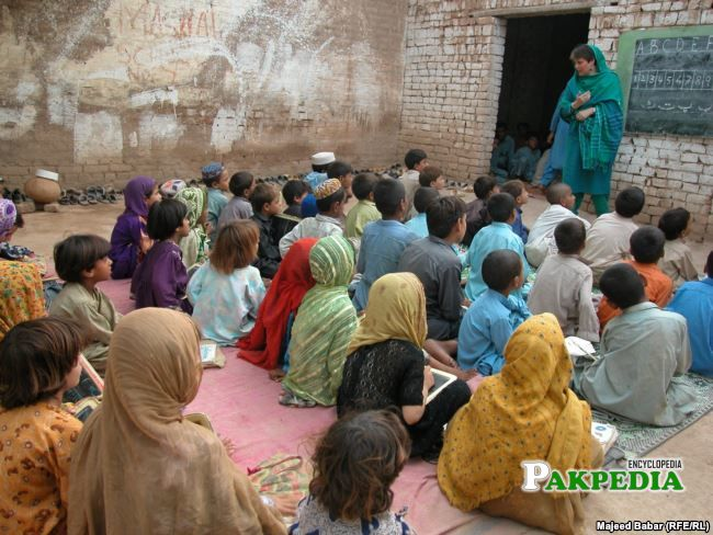 Bushra Gohar talking to school children at a school near Peshawar