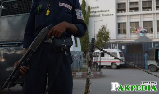 A private security guard stands outside the Jinnah Postgraduate Medical Centre in Karachi on March 23