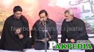 With mir hassan mir on left reciting marsiya on Hadi tv