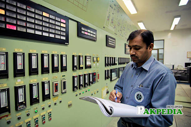 An engineer records data in the control room of the Dakhni Gas Processing Plant, operated